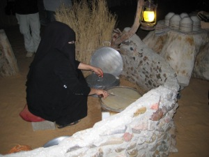 Lady in hijab makes pita bread